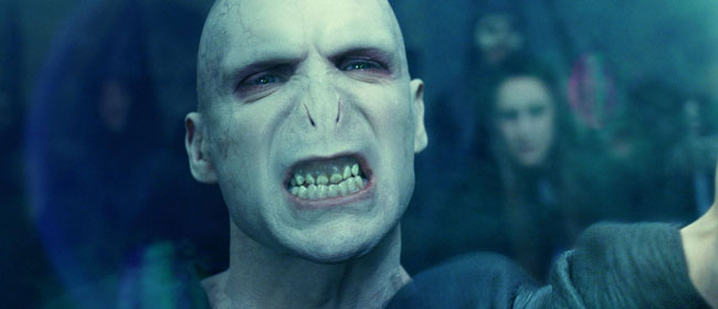 Voldermort growling, showing his teeth. Voldermort is one of the iconic movie villains that scared you silly.