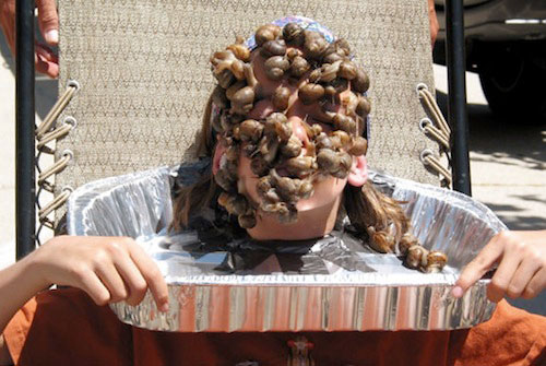 Crazy world records. Most snails on your face.