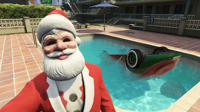 Man dressed as santa taking a selfie with a car in a pool on GTA V.