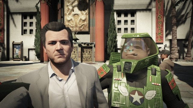 Michael taking a selfie with a man in a green space suit on GTA V.