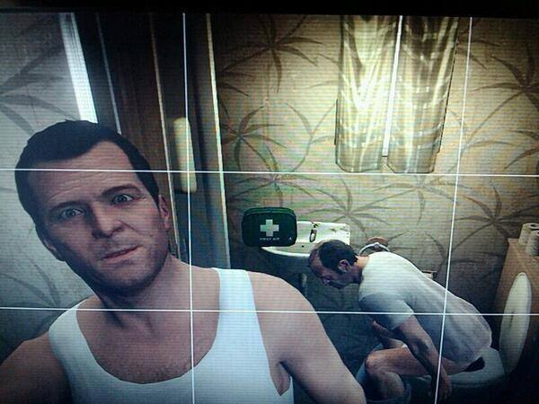 Michael taking a selfie with Trevor on the toilet on GTA V.