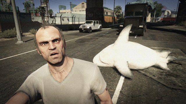 Trevor taking a selfie with a shark in the middle of the road on GTA V.