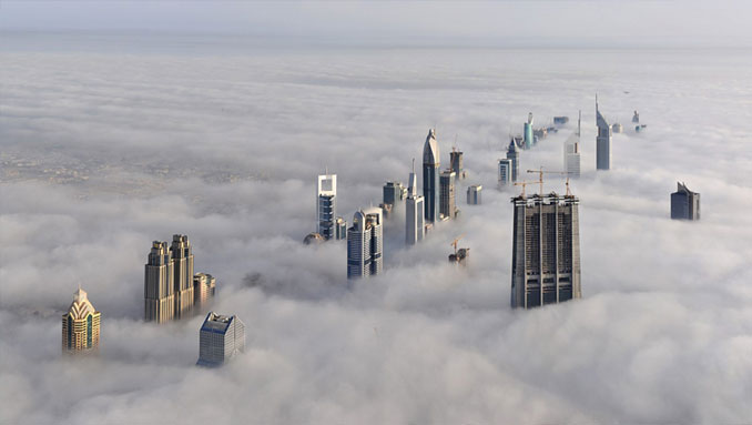 A Photo Taken From The Burj Khalifa in Dubai, UAE Of A Cloudy Dubai Skyline - 10 Eerie Photos That Will Send Shivers Down Your Spine