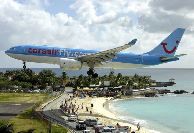 A plane landing at Maho beach - 10 photos you won't believe weren't photoshopped.
