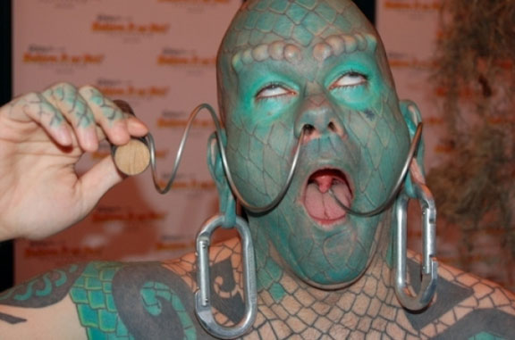 The Lizardman Erik Sprague with a corkscrew through his nose - 10 Most Insane Body Modifications You Just Have To See