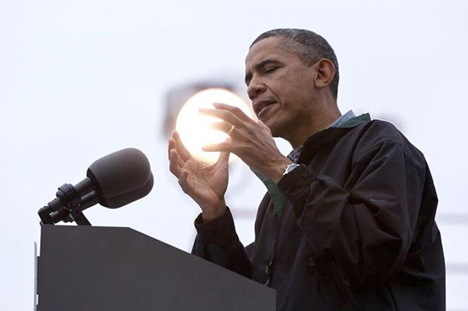 A photo that looks like Barack Obama is holding a glowing orb - 10 Amazing Photos Taken At Just The Right Time