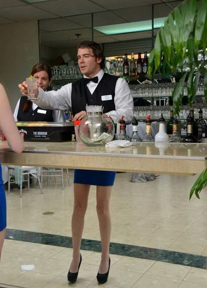 A photo of a male bartender with female legs in high heels - 10 Amazing Photos Taken At Just The Right Time