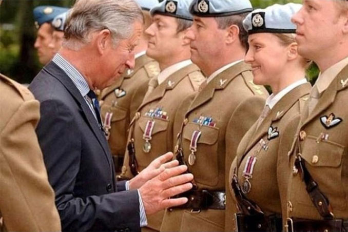 A photo of Prince Charles reaching for a female soldier - 10 Amazing Photos Taken At Just The Right Time
