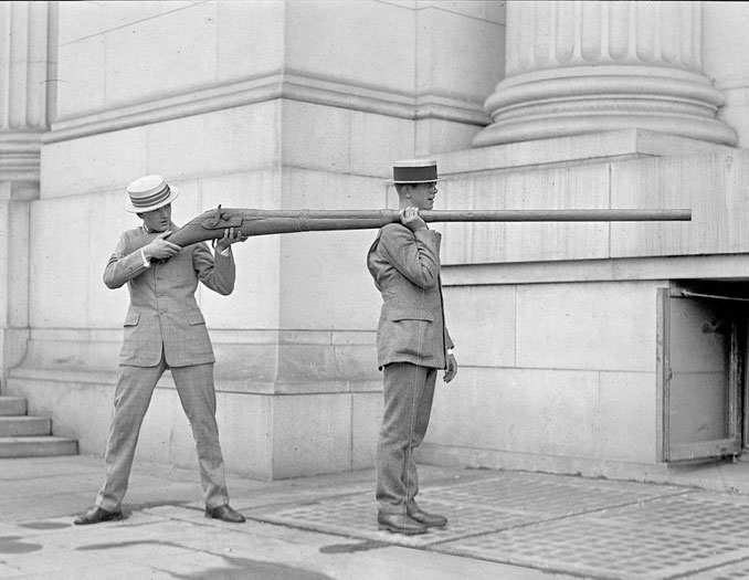 A photo of two men with a punt gun - 10 Rare Photos From History