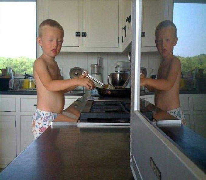 A photo of a boy blinking but his eyes are open in the reflexion off the T.V. - 20 WTF Photos You Just Have To See