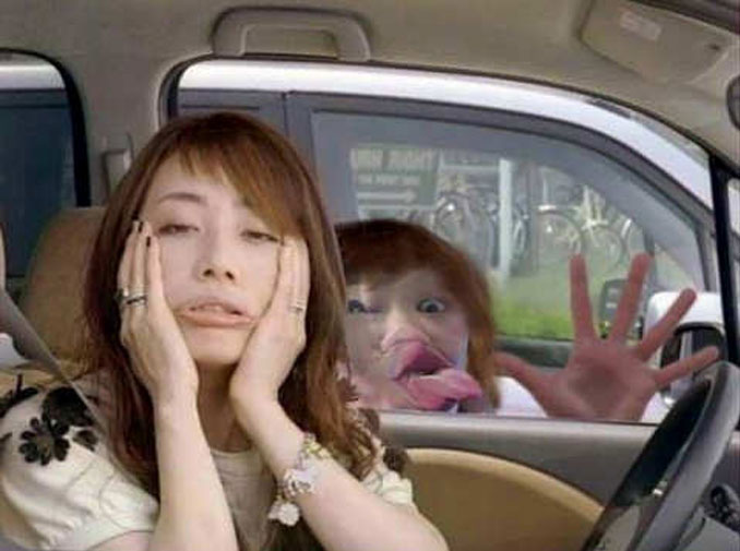 A girl in a car pulling a funny face while someone behind her presses their face against the car window - 10 Most Chilling Photobombs Ever Caught On Camera