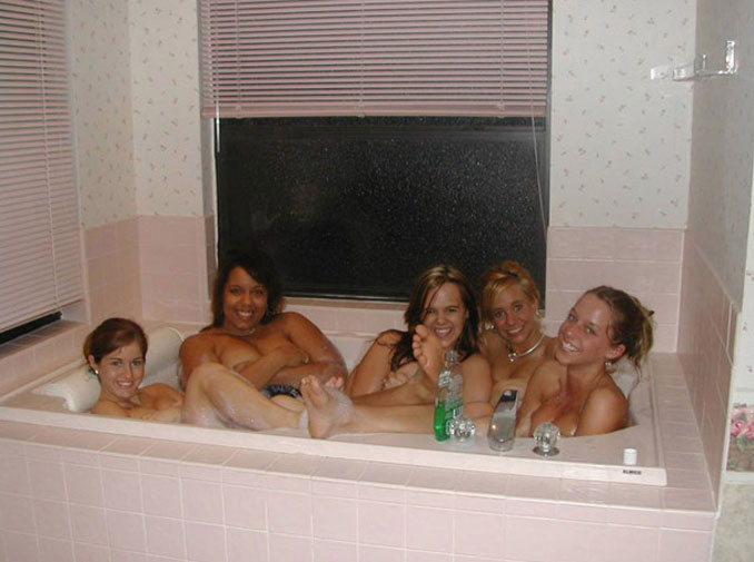 A person photobombing a group of girls in a bathtub - 10 Most Chilling Photobombs Ever Caught On Camera