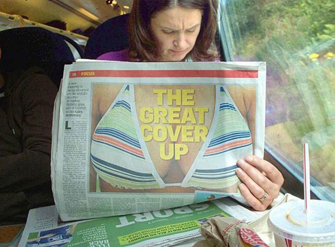 A lady holding a newspaper with a picture of a bikini on it - 20 WTF Photos You Just Have To See