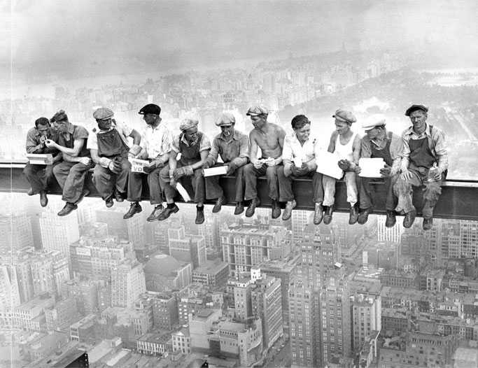 Workers sitting on a tall beam during construction of the Empire State Building - 20 WTF Photos You Just Have To See