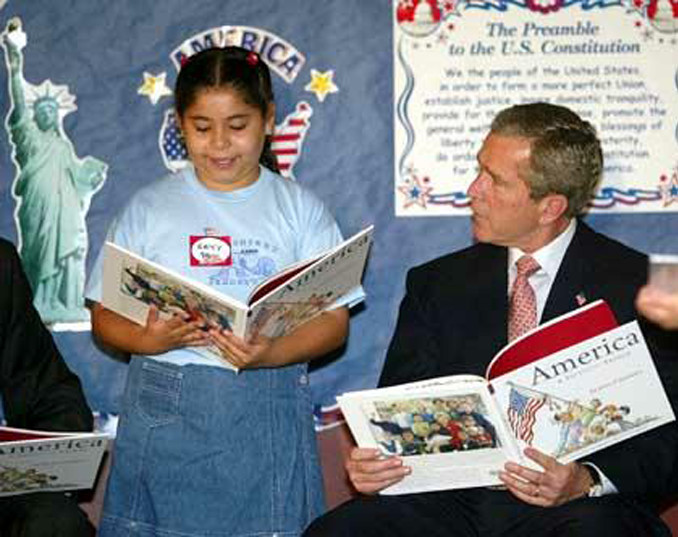 Former President Bush holding the book the right way around.