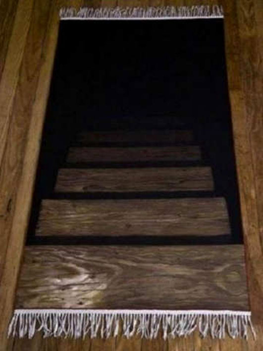 A door mat designed to look like it is stairs leading to the basement.