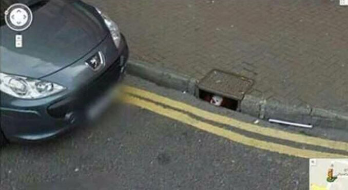 A clown in the sewer seen on Google Street View.
