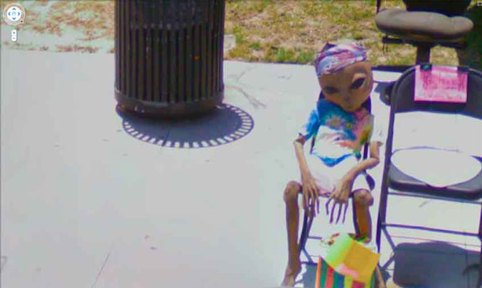 An alien sitting on a chair seen on Google Maps.