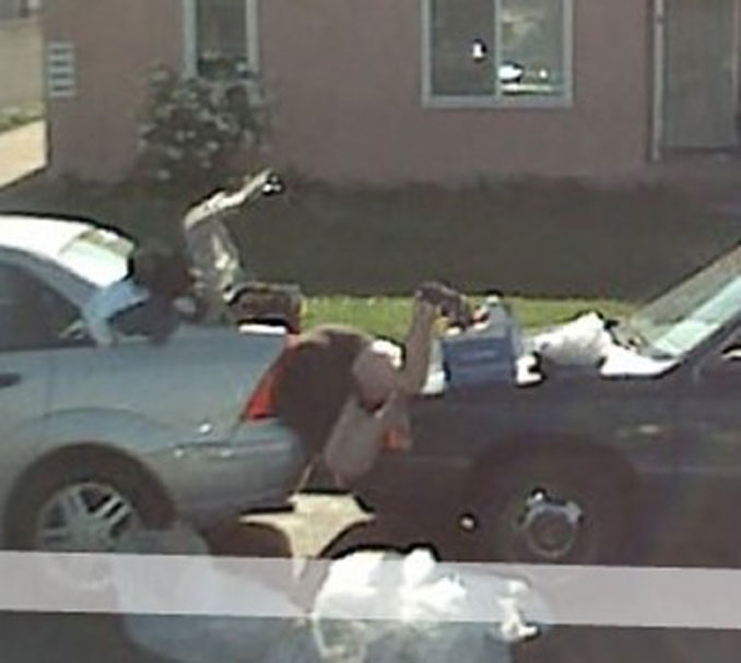 A lady stuck between two cars seen on Google maps.