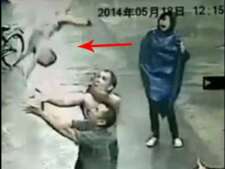 Here's a crazy moment caught on CCTV when a baby fell from a two storey apartment window sill.