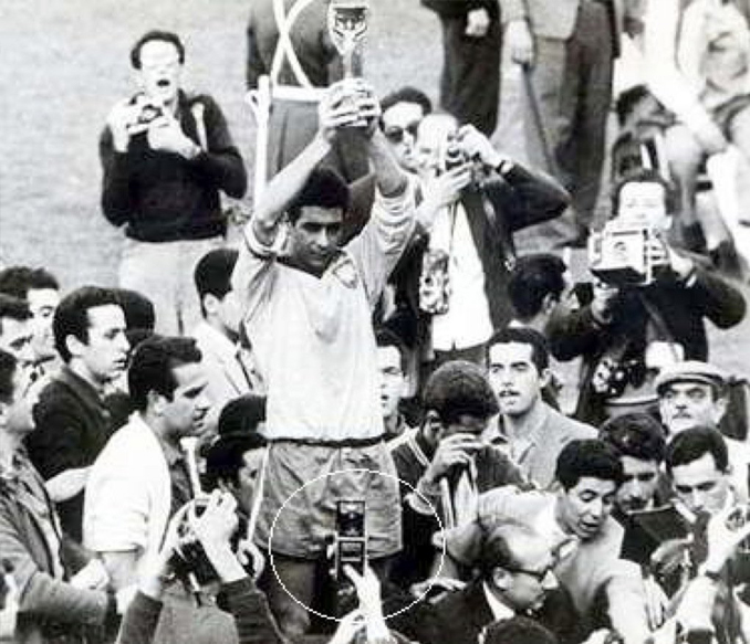 Man with cell phone at the 1962 FIFA World Cup - 10 REAL Cases Of Time Travel That Cannot Be Explained
