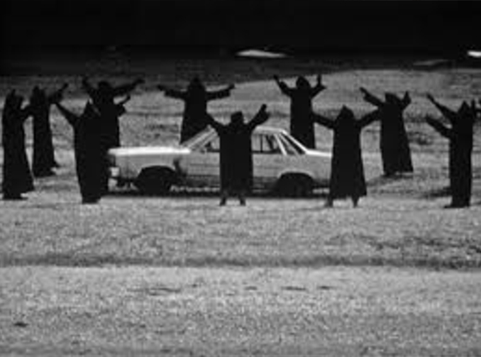 Creepy cult surround car, it's one of many real photos that have left skeptics stumped