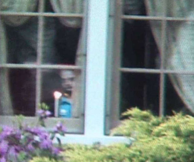 Ghost child looking out of a window in Ravenna, Ohio - 10 Photos of Ghost Children That Have Everyone Scared