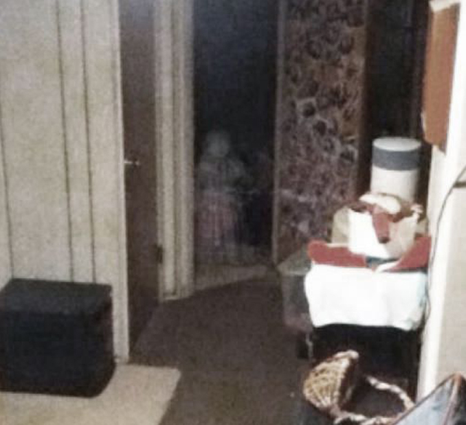 Ghost child looking through door - 10 Photos of Ghost Children That Have Everyone Scared