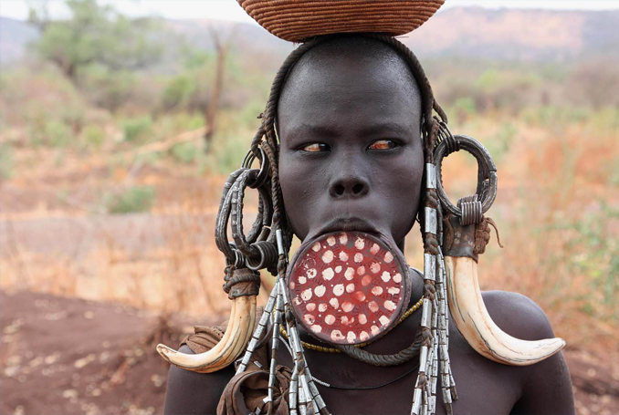 The curious Mursi tribe in Africa are one of the most Most Isolated and Dangerous Tribes in the World